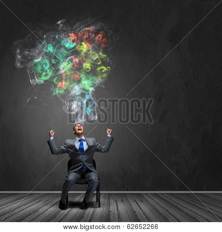 Young tired businessman screaming angrily. Creativity concept