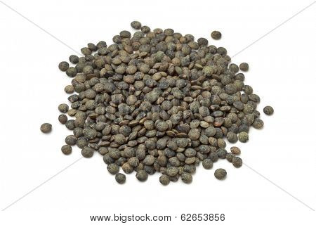 Heap of du Puy lentils on white background