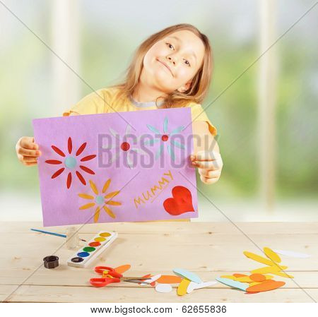 Girl Holds Greeting Card
