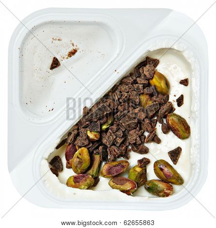 Peach Flavored Greek Yogurt with Pistachio and Chocolate Sprinkles Over White.