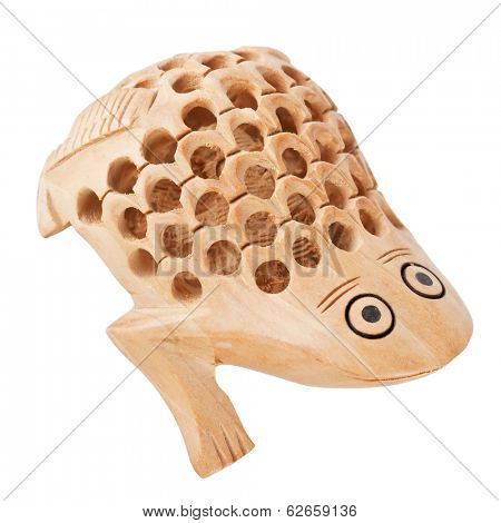 carved wooden toad on white background