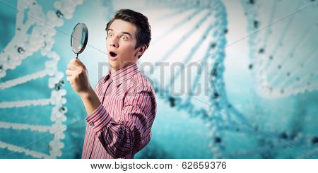 Young man in casual looking in magnifier
