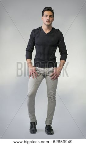 Full Body Photo Of Young Man Standing On Grey Background