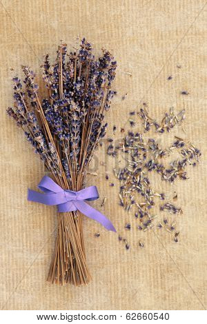 Lavender flower posy over old brown paper background.