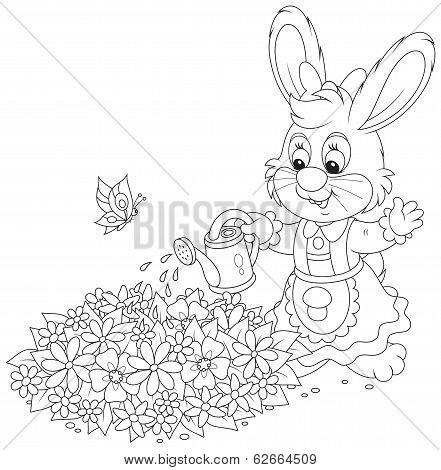Easter Bunny watering flowers
