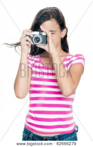 Cute young girl taking a photo with her hair floating in the air (looking through the viewfinder , isolated on white)
