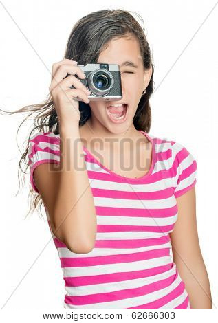 Happy young girl taking a photo with a vintage looking compact camera witha funny expression  (isolated on white)