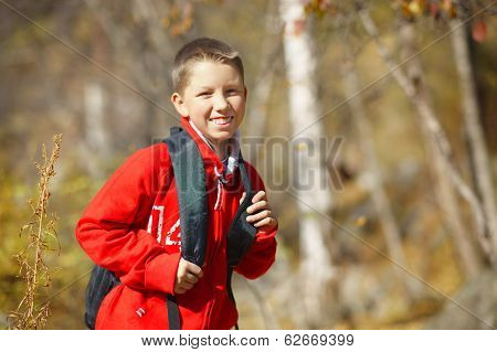 Happy Smiling Hiker Boy With Backpack In Forest. Dressed In Red Sweatshirt.