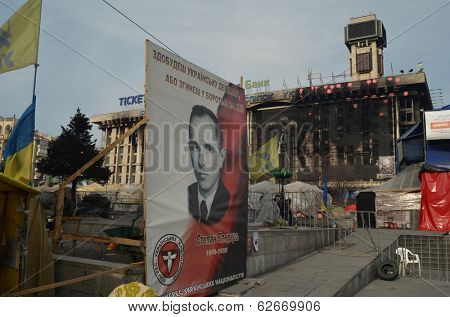KIEV, UKRAINE - Mar 24, 2014: Stephan Bandera poster (Ukrainian nationalist icon ) near Burnt down the House of trade unions.Riot in Kiev and Western Ukraine.March 24, 2014 Kiev, Ukraine