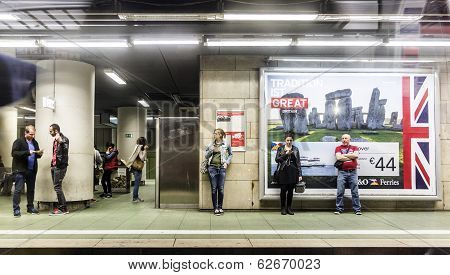 People Wait In The Subway Station For The Train