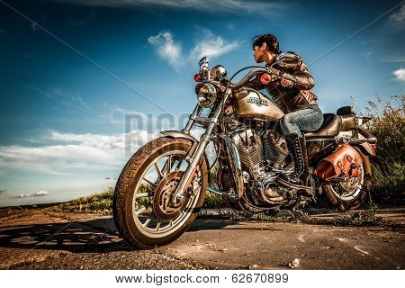 MOSCOW, RUSSIA-JULY 7, 2013: Biker girl on Legendary bike Harley Sportster. Harley-Davidson sustains a large brand community which keeps active through clubs, events, and a museum.
