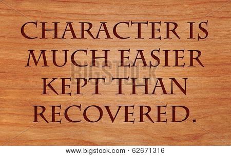 Character is much easier kept than recovered - quote by Thomas Paine on wooden red oak background