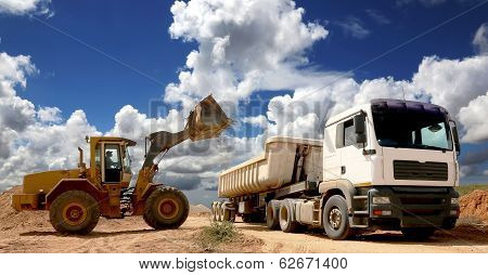 Front End Loader Filling Truck