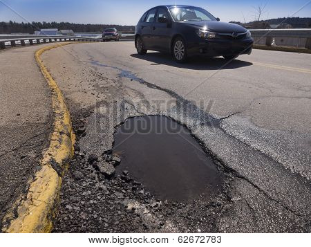 Pot hole and car
