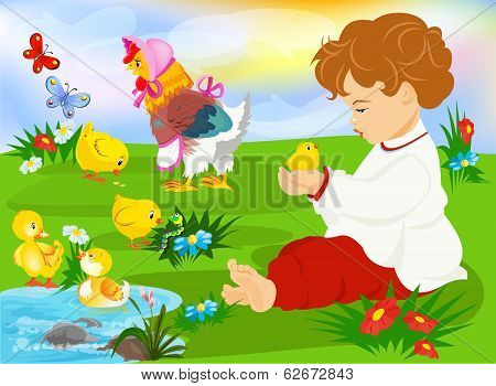 Cute  child holding a baby chicken on the meadow