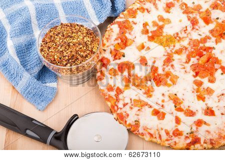 Tomato Pizza With Red Pepper Flakes And Cutter