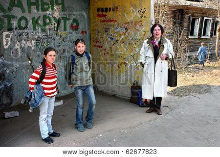 Rural Areas In Russia, Schoolgirl Waiting At Bus Stop