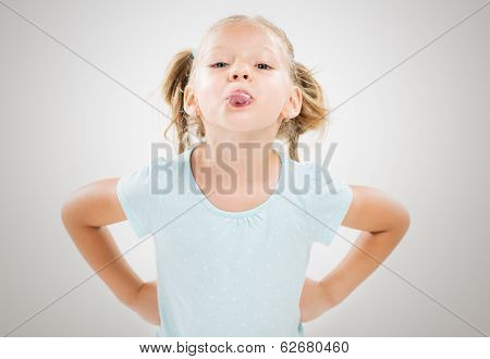 Little Girl Sticking Her Tongue Out