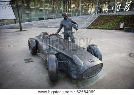 STUTTGART, GERMANY - MARCH 30, 2014: Sculpture of Mercedes-Benz W196R Silberpfeil (1954) and race car driver, a multiple champion of Formula-1 Juan Manuel Fangio