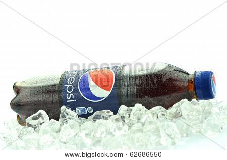Bottle of Pepsi drink on ice isolated on white