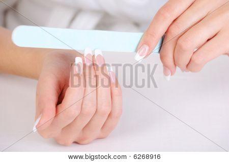 Female Polishing Her Fingernails