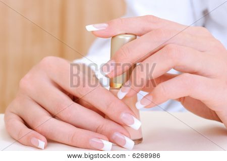 Beautiful Female Hands With Holding Bottle Enamel