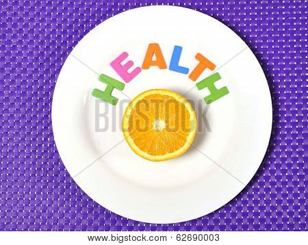 Halved Fresh And Healthy Orange Fruit Stillife And Health Word On Plate