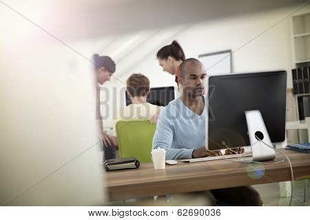 Man working on desktop computer