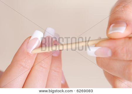 Female Cleaning Cuticle On Hands