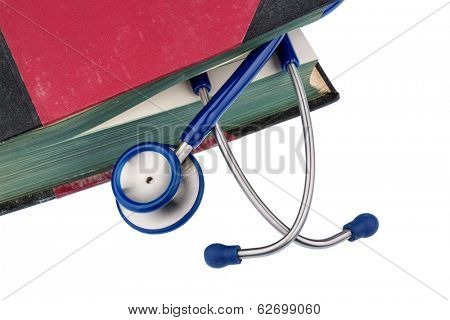 book and stethoscope, symbol photo for bungling, doctors errors and expertise