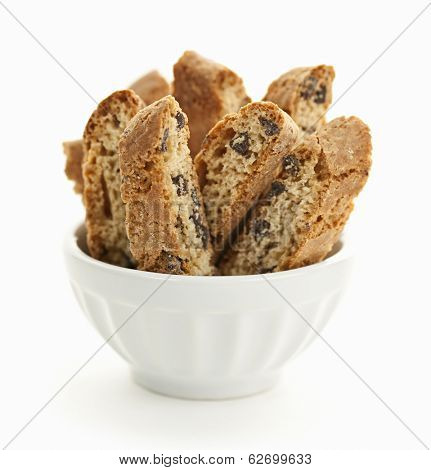 Italian chocolate chip biscotti in bowl isolated on white background