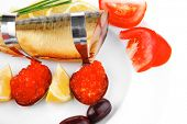 diet food - red caviar and smoked mackerel fish with lemon tomatoes and bread on white china plate i
