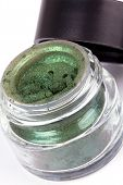 picture of pigment  - Open tube with green pigment closed-up on white