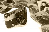 pic of outdated  - The outdated film camera and ancient black white photos on a white background - JPG