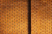 stock photo of tile cladding  - grungy rough red colored sandstone cladding wall - JPG