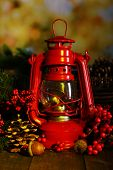 picture of kerosene lamp  - Red kerosene lamp on dark natural background - JPG