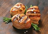 foto of crystal salt  - portion of three grilled pork tenderloin medallions with fresh herbs and crystal salt - JPG