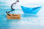 stock photo of bon voyage  - Ship with a Label with Bon Voyage on it which means Safe Journey - JPG