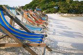 picture of yuan  - Row of sun beds in the beach of Nang Yuan Thailand - JPG