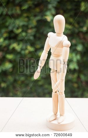 Wooden Artist Manikin Pose On The Table