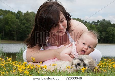 Baby Want's To Stroke The Puppy