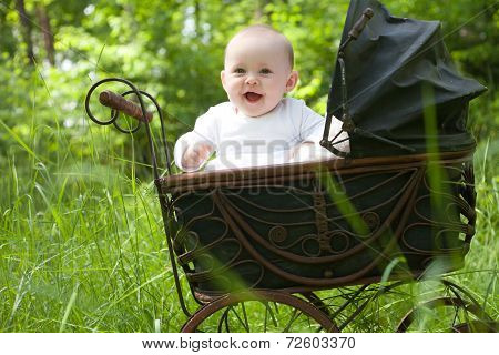 Happy Baby In Vintage Pram