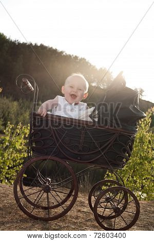 Happy Girl In Her Pram