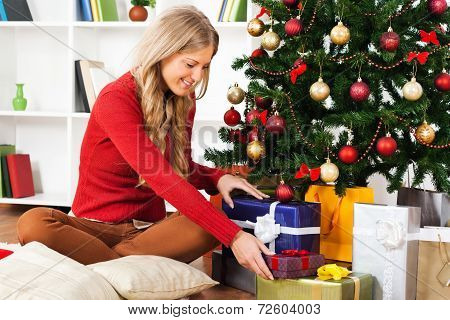 ,Young woman with Christmas presents