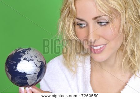 Beautiful Blond Woman With Globe On Green Background