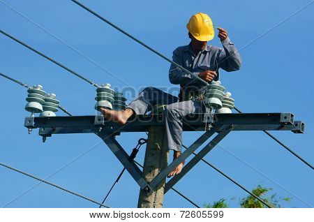 Asian Electrician Climb High, Work On Electric Pole