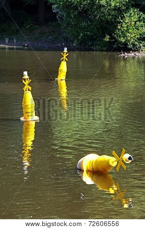 Yellow marker buoys on the River Dee.