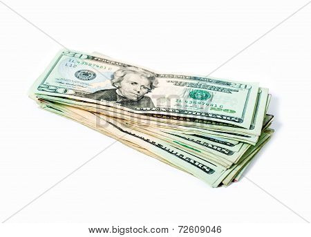 Stack of money american twenty dollar bills over white.