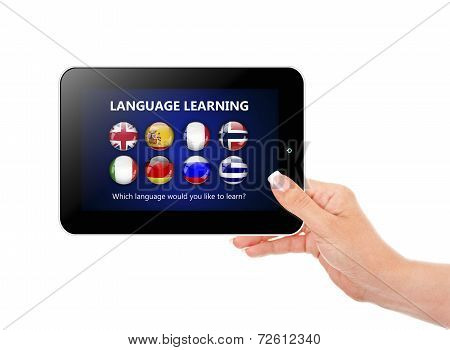 Hand Holding Tablet With Language Learning Page Over White
