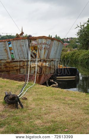 Salvage Hull Moored By A Canal